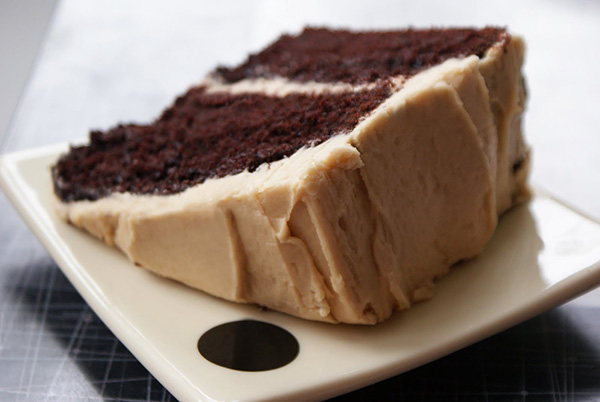 choclate and cream cake on a square plate