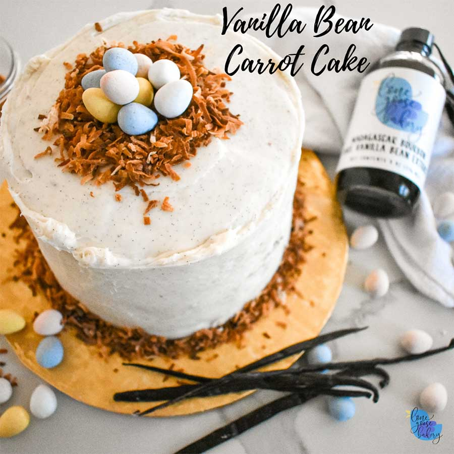 Vanilla Bean Carrot Cake next to Vanilla Beans and Extract