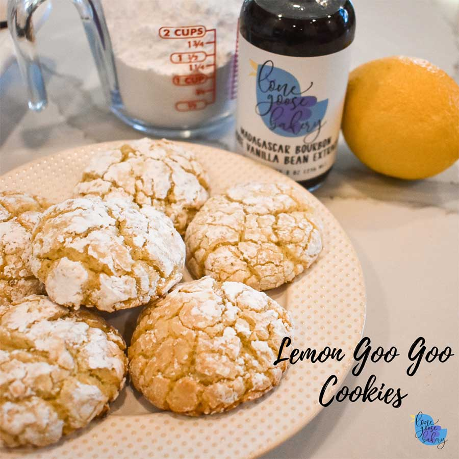 Lemon Goo Goo Cookies on a plate next to Vanilla Extract
