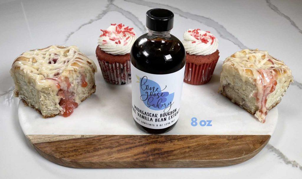 8 oz of vanilla extract next to pastries