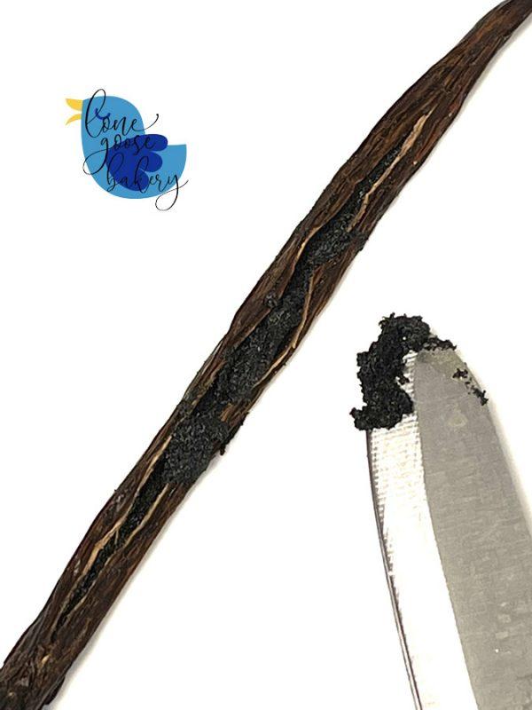 a split vanilla bean exposing the interior of the bean
