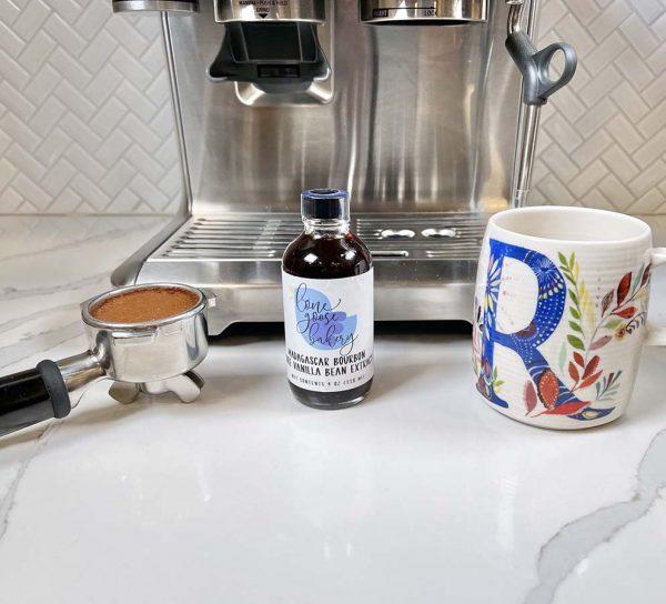 vanilla extract next to a mug