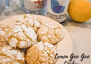 Lemon Goo Goo Cookies on a plate next to Vanilla Extract